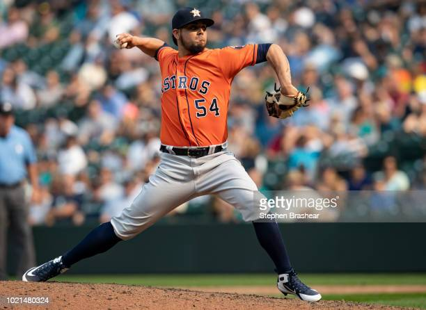 Reliever Roberto Osuna of the Houston Astros delivers a pitch during the ninth inning of a game against the Seattle Mariners at Safeco Field on...