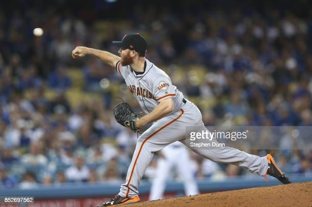 Reliever Sam Dyson of the San Francisco Giants throws a pitch in the ninth inning on his way to picking up the save against the Los Angeles Dodgers...