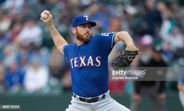 Reliever Sam Dyson of the Texas Rangers delivers a pitch during the ninth inning of a game against the Seattle Mariners at Safeco Field on April 16...