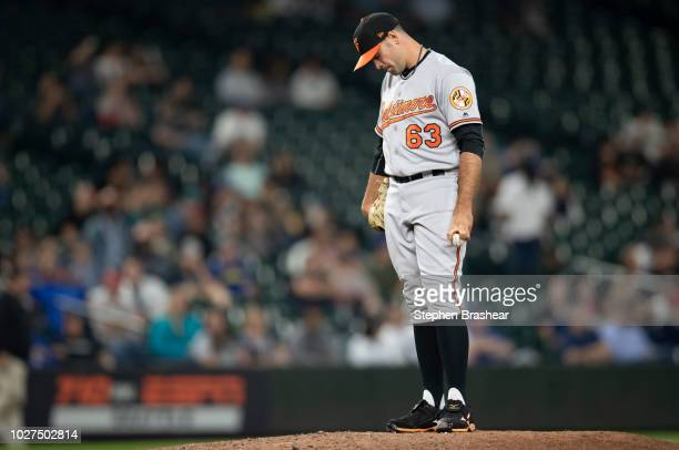 Reliever Sean Gilmartin of the Baltimore Orioles reacts after giving up a RBIsingle to Denard Span of the Seattle Mariners that scored Nelson Cruz of...