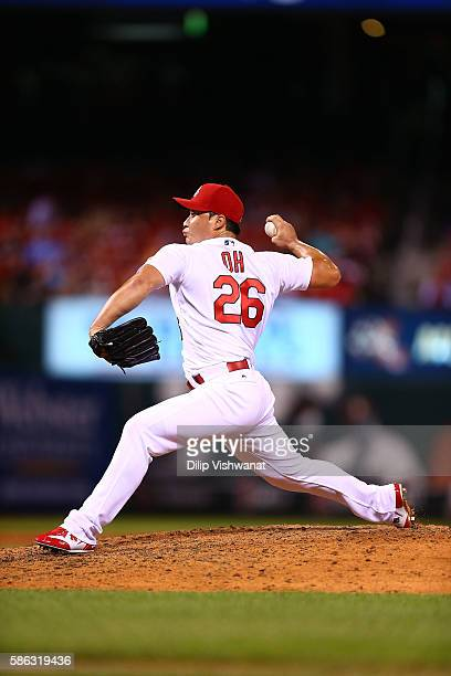Reliever Seung Hwan Oh of the St Louis Cardinals pitches against the Atlanta Braves in the ninth inning at Busch Stadium on August 5 2016 in St Louis...