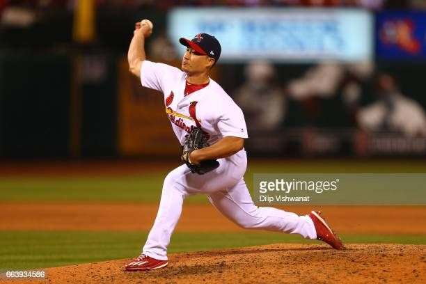 Reliever SeungHwan Oh of the St Louis Cardinals pitches against the Chicago Cubs in the eighth inning during the 2017 MLB Opening Day at Busch...