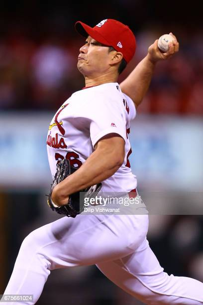Reliever SeungHwan Oh of the St Louis Cardinals pitches against the Milwaukee Brewers in the tenth inning at Busch Stadium on May 1 2017 in St Louis...