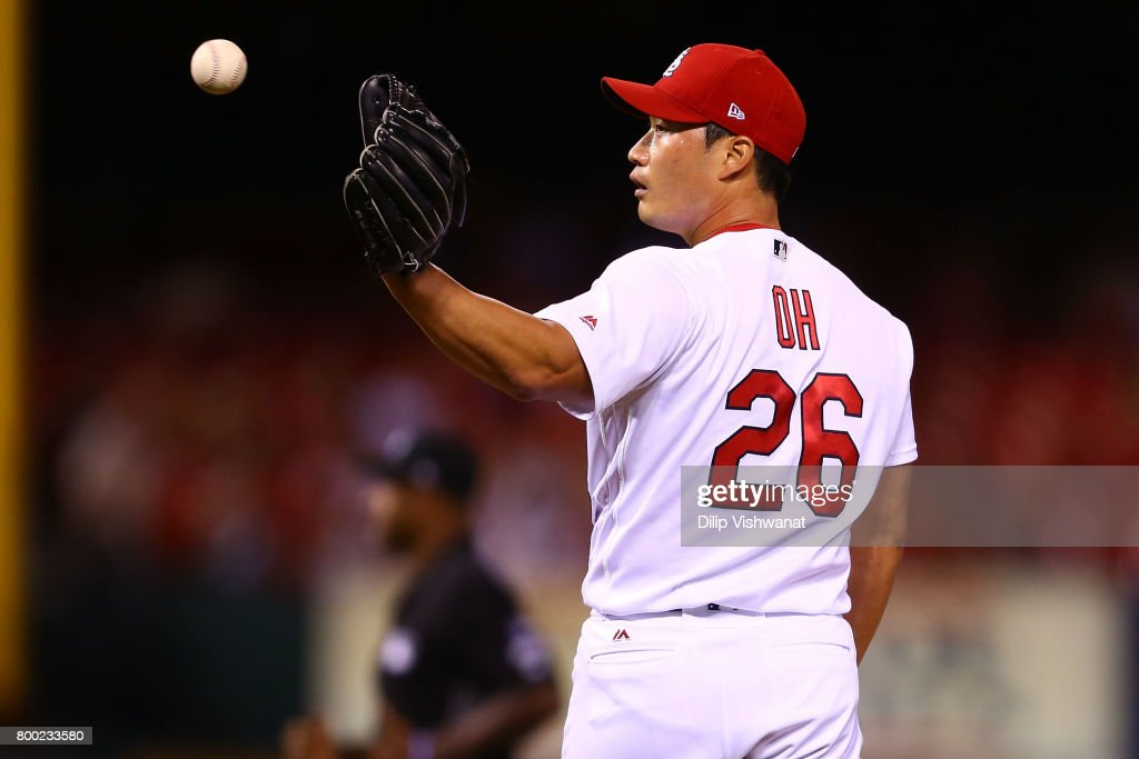 Reliever Seung-Hwan Oh #26 of the St. Louis Cardinals reacts after giving up the game-winning home run against the Pittsburgh Pirates in the ninth inning at Busch Stadium on June 23, 2017 in St. Louis, Missouri.