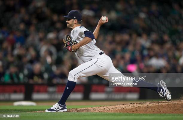 Reliever Steve Cishek of the Seattle Mariners delivers a pitch during the seventh inning of a game against the Colorado Rockies at Safeco Field on...