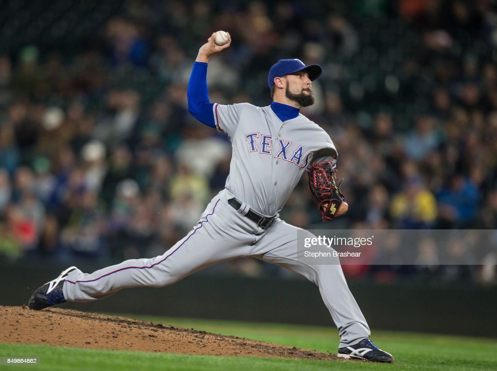 Reliever Tony Barnette #43 of the Texas Rangers delivers a pitch during the seventh inning of a game against the Seattle Mariners at Safeco Field on September 19, 2017 in Seattle, Washington. The Rangers won the game 3-1.