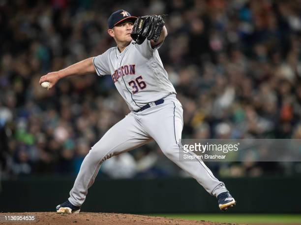 Reliever Will Harris of the Houston Astros delivers pitch during the seventh inning of a game against the Seattle Mariners at TMobile Park on April...