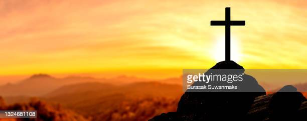 religion christ and the cross of jesus christ at sunset, golden light. - bible stock pictures, royalty-free photos & images