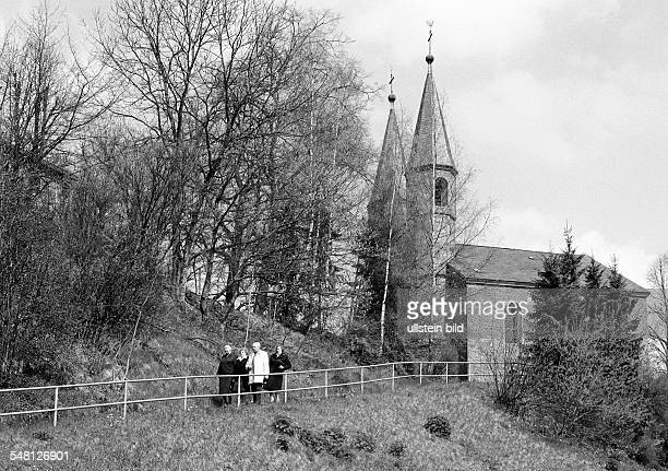 religion Christianity older people undertake a walk after the church service Sauerland North RhineWestphalia