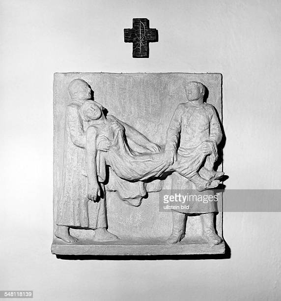 religion Christianity passion way of the cross 14th station The Entombment of Christ sculptures relief