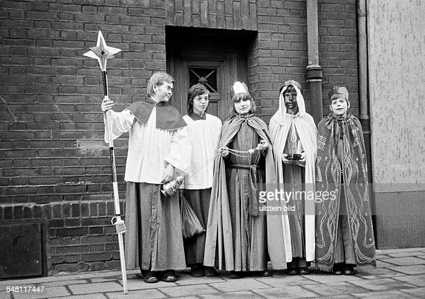 religion Christianity Star Boys Singing Procession Star boys in the costumes of Caspar Melchior and Balthasar pose in front of a civil house aged 14...