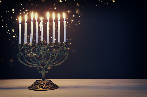 Religion image of jewish holiday Hanukkah background with menorah (traditional candelabra) and candles 1185319773
