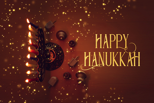 religion image of jewish holiday Hanukkah background with menorah (traditional candelabra), candles and spinning top 1193894051