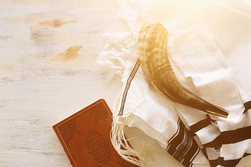 religion image of Prayer Shawl - Tallit, Prayer book and Shofar (horn) jewish religious symbols. Rosh hashanah (jewish New Year holiday), Shabbat and Yom kippur concept. 1172842180