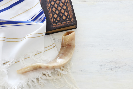 religion image of Prayer Shawl - Tallit, Prayer book and Shofar (horn) jewish religious symbols. Rosh hashanah (jewish New Year holiday), Shabbat and Yom kippur concept. 1172842181