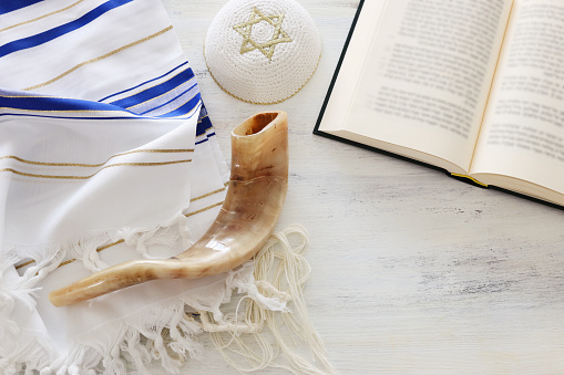 religion image of Prayer Shawl - Tallit, Prayer book and Shofar (horn) jewish religious symbols. Rosh hashanah (jewish New Year holiday), Shabbat and Yom kippur concept. 1172842192