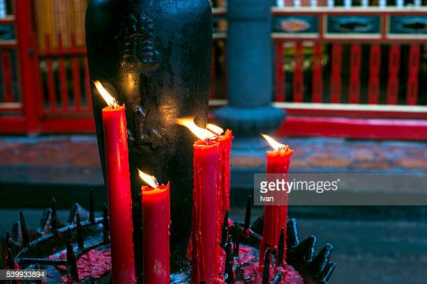 Religion in China: Burning Red Candle in Traditional Chinese Temple