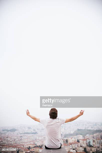 religion - young adult arms raised with urban scene - miracle stock photos and pictures