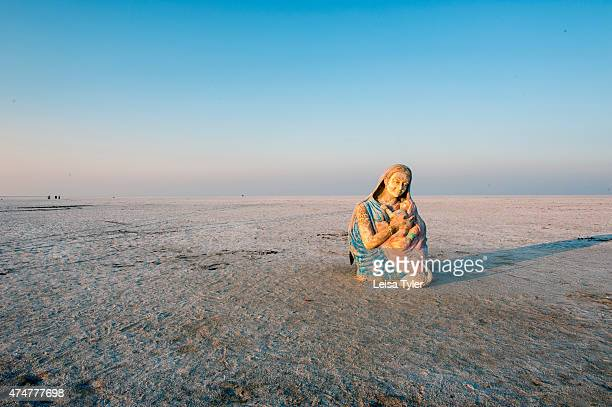 A religions statue believed to have been dumped after a Hindu festival in the nearby town of Hodka stands at the edge of the Great Rann of Kutch a...