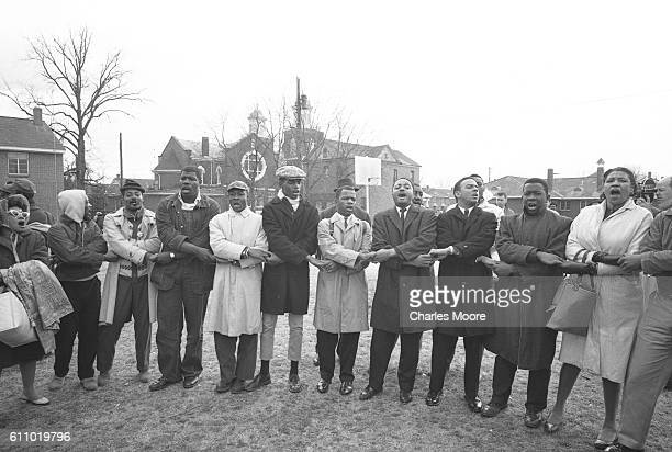Religious and Civil Rights leaders and others hold hands in song and prayer prior to the start of the first Selma to Montgomery March, Selma,...