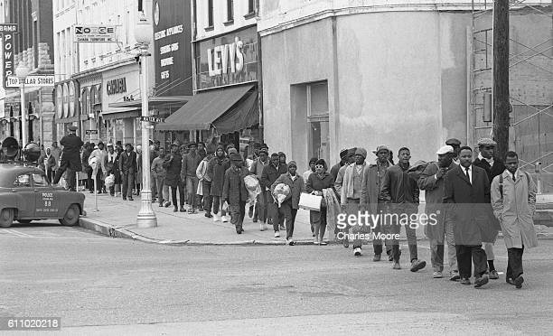 Religious and Civil Rights leaders lead others along Broad Street as they walk towards the Edmund Pettus Bridge during the first Selma to Montgomery...