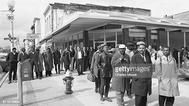 Religious and Civil Rights leaders lead others gather on Broad Street as they prepare to walk towards the Edmund Pettus Bridge during the first Selma...