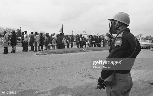 Religious and Civil Rights leaders stand at the head of the first Selma to Montgomery March after crossing the Edmund Pettus Bridge where they were...