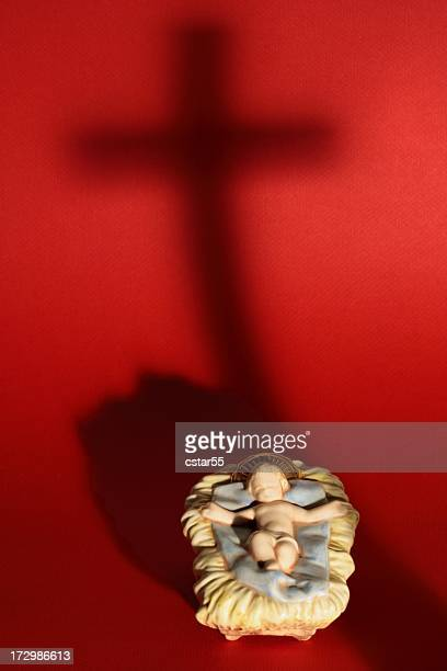 Religious: Baby Jesus in manger and Cross shadow