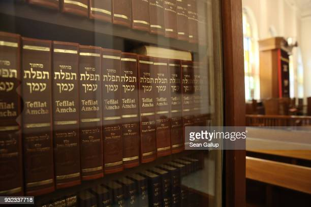 Religious books in Hebrew line shelves in a synagogue still in use by the local Jewish community in the surviving adjunct building of the former...