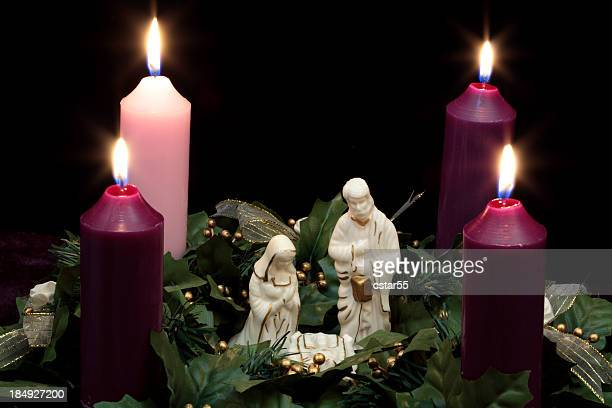 religious: christmas advent wreath with nativity scene 2 - catholic church christmas stock photos and pictures