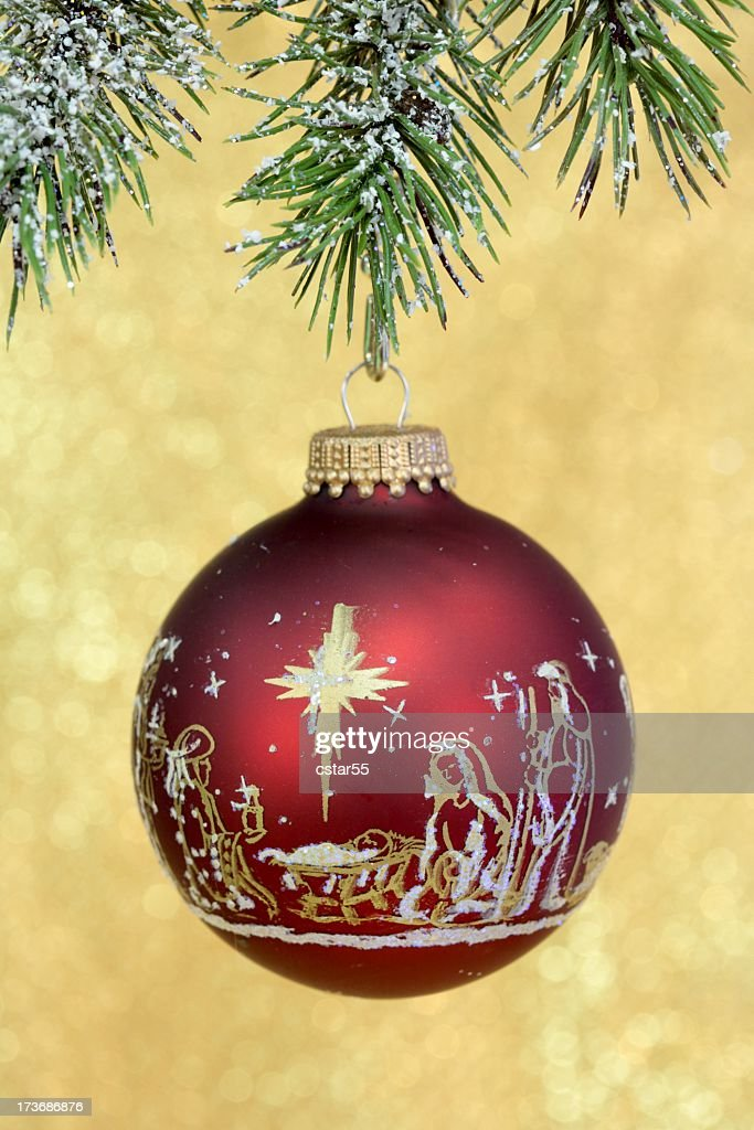 religious christmas nativity scene on red ornament stock