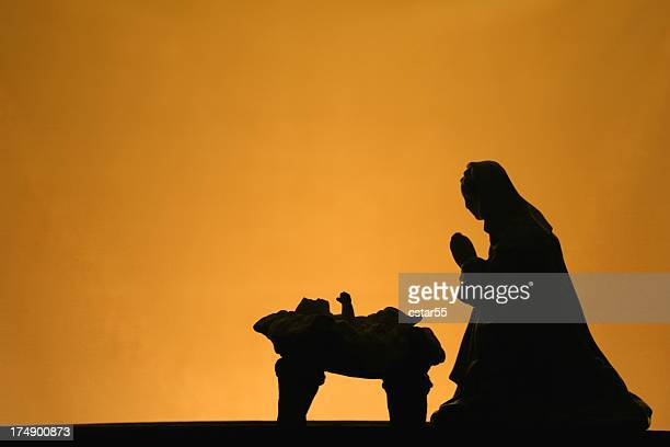 religious: christmas nativity silhouette on gold background - catholic church christmas stock photos and pictures