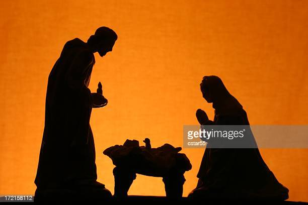 religious: christmas nativity trio silhouette on gold - nativity stock photos and pictures