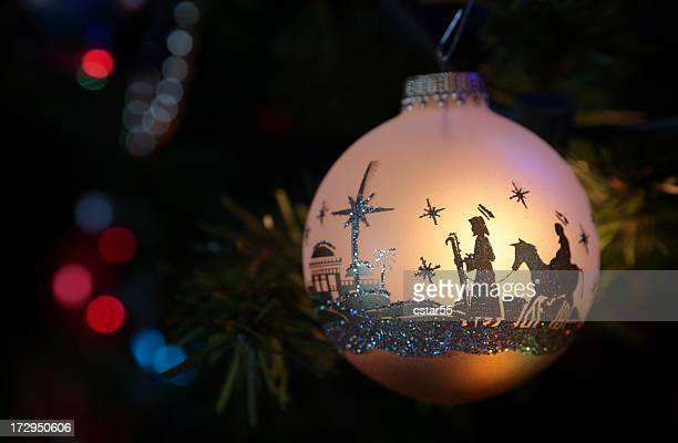 religious: christmas ornament with nativity silhouette - manger stock photos and pictures