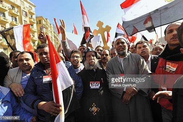 A religious Coptic and Muslim cleric meet to call for mutual respect during a rally on Tahrir Square on February 18 2011 in Cairo Egypt Thousands of...