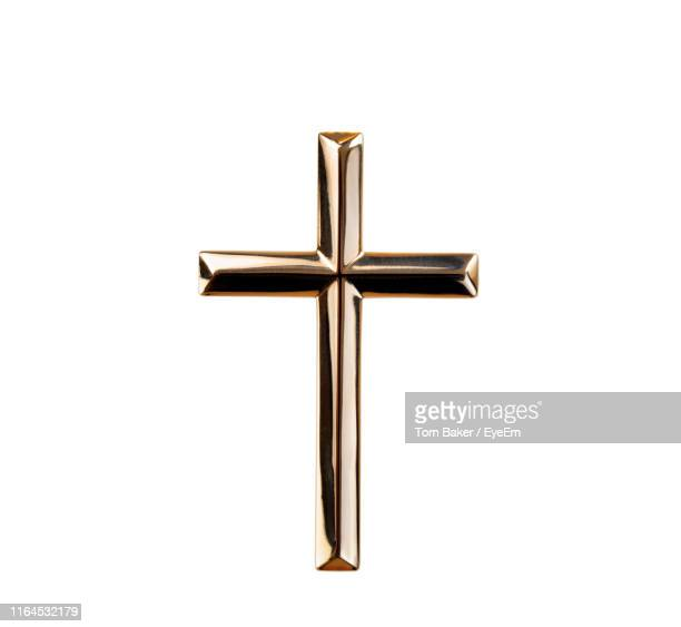 religious cross against white background - religious cross stock pictures, royalty-free photos & images