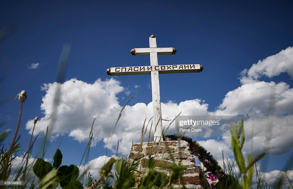 A religious cross marks the entrance of the village Grabovo, on the so called burnsite of the MH17 catastrophe, on May 15, 2015 in Grabovo, Ukraine, Ukraine. On 17 July 2014, 283 passengers and 15 crew died above an area controlled by pro-Russian rebels when Malaysian Airlines flight MH17 from Amsterdam on its way to Kuala Lumpur was shot down by a Buk surface-to-air missile.