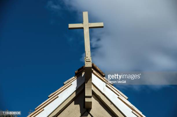 religious cross on a building's gable - church stock pictures, royalty-free photos & images