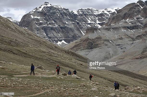 Religious faithful hike around the snowcapped Kangrinboqe Mountain known as Mt Kailash in the West June 15 2007 in Purang County of Tibet Autonomous...