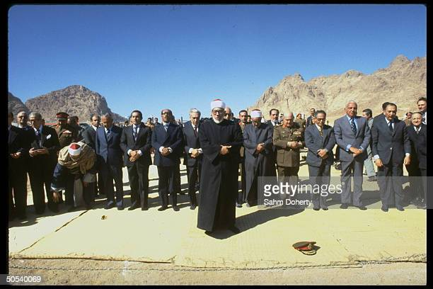 Religious figure leading ceremony w Egyptian Pres Anwar Sadat US Trade Ambassador Robert Strauss Gen Kamal Hasan Ali w others in attendance