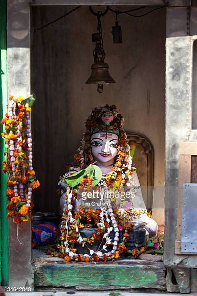 Religious icon on display during Festival of Shivaratri in temple window in the city of Varanasi Benares Northern India