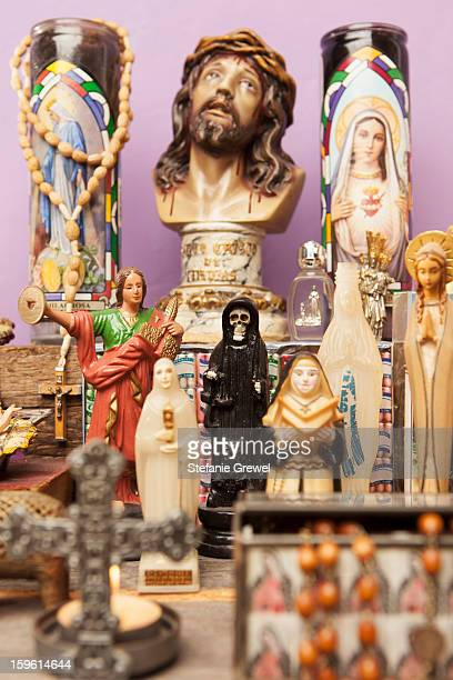 Religious icons and crosses on table
