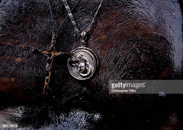 Religious icons being worn around man's neck