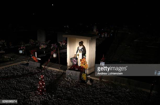 Religious icons decorate the Hayden cemetery where a lot of Mexican American copper miners are buried The small mining communities of Kearny and...