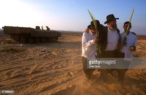 Religious Israelis welcome Israeli soldiers returning for rest from the Gaza Strip with the four plants of Sukkot the Jewish feast of the Tabernacles...