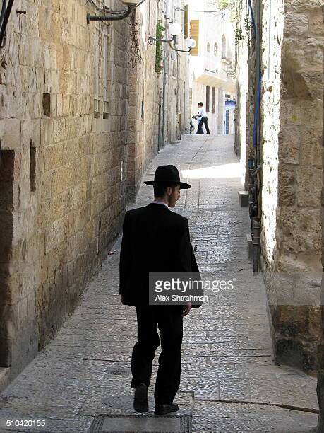 Religious Jew walking thru the alleys of the old city of Jerusalem