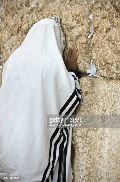 Religious jew wearing a shawl praying at the Wailing Wall in the old city pictured on November 17 2005 in Jerusalem Israel
