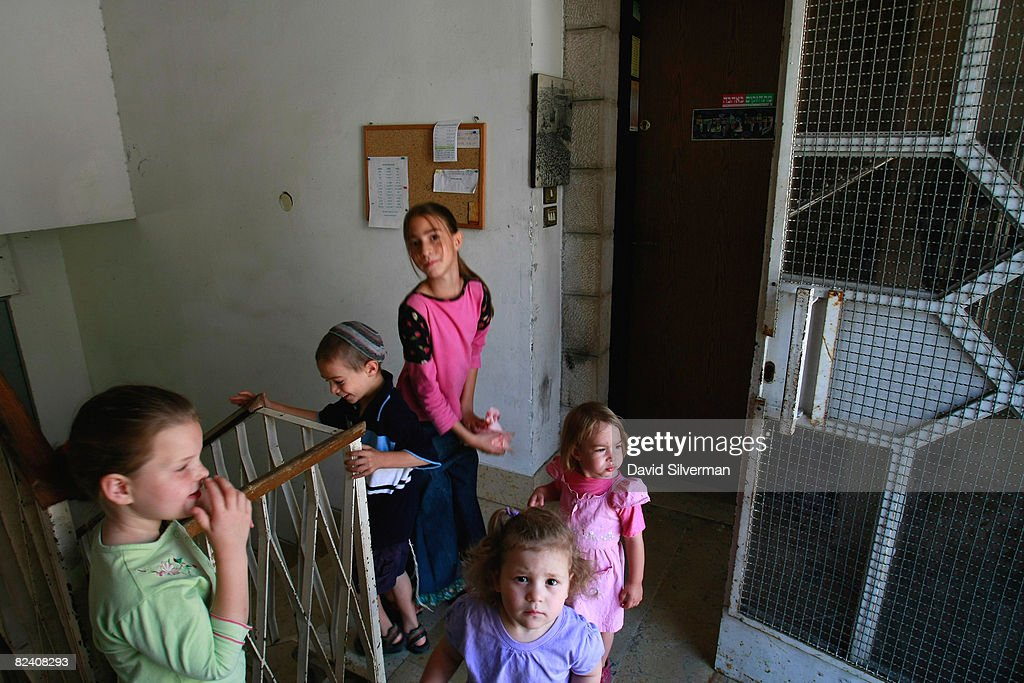 Religious Jewish children gather at the entrance to their settlement in the Arab neighborhood of Abu Tor August 18, 2008 in East Jerusalem, Israel. The settlement, an apartment building which houses a number of families, is a former Arab home purchased by the Ateret Cohanim organization, which is dedicated to expanding Jewish settlement in East Jerusalem, the half of the city that Israel captured from Jordan in the 1967 Six Day War.