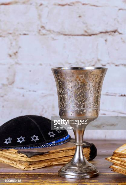 religious jewish objects, kiddush cup, kippah, matzoh - happy passover stock pictures, royalty-free photos & images
