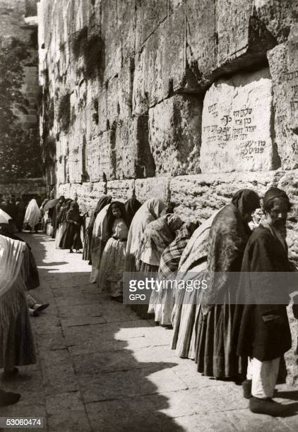 Religious Jews pray at the Western Wall Judaism's holiest site July 1 in Jerusalem's Old City during the Ottoman rule of Palestine in what would...